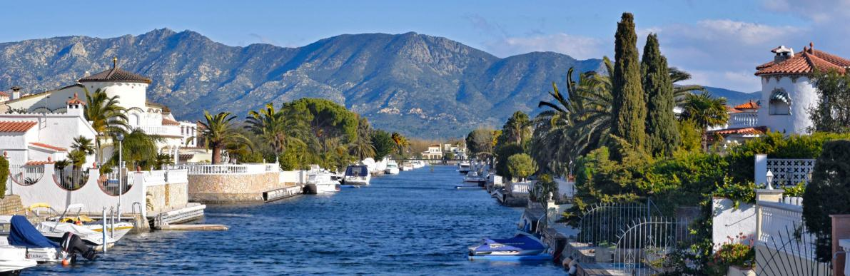 Empuriabrava canal with Pyrenees in background